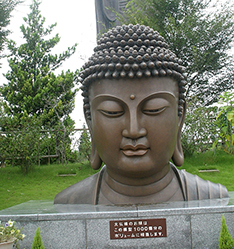 large outdoor temple building buddha bust statue