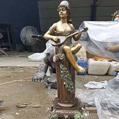 copper sculpture life size boy play music