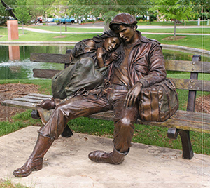 boy and girl lower statue sitting on bench