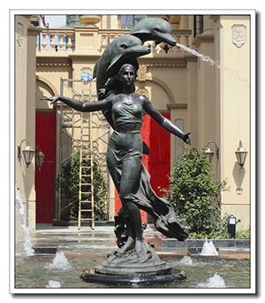life size lady statue with 2 dolphin