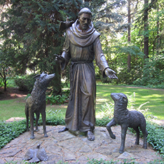 religious saint bronze sculpture Antonio with sheep and wolf