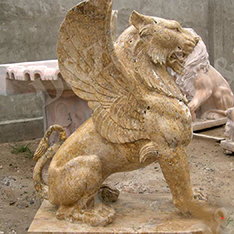 Yellow travertine winged lion statue