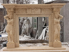 yellow limestone woman statue indoor fireplace mantel