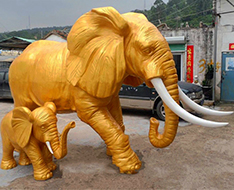 Fiberglass mother elephant and baby sculpture