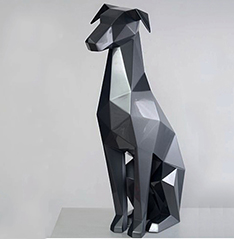 Sitting fiberglass black dog sculpture